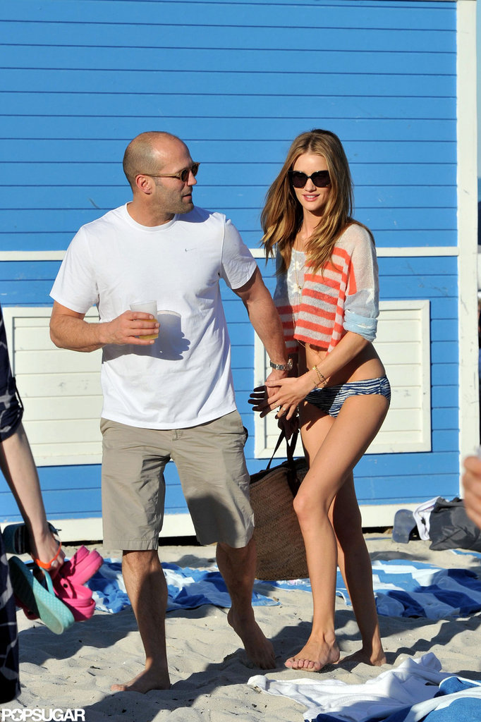 Rosie Huntington-Whiteley covered up her bikini with a flag top while on the beach in Miami with Jason Statham in December 2011.