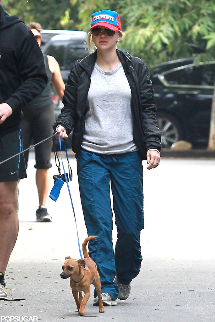 Anna Faris looked cute and comfortable in bright blue pants and a hat.