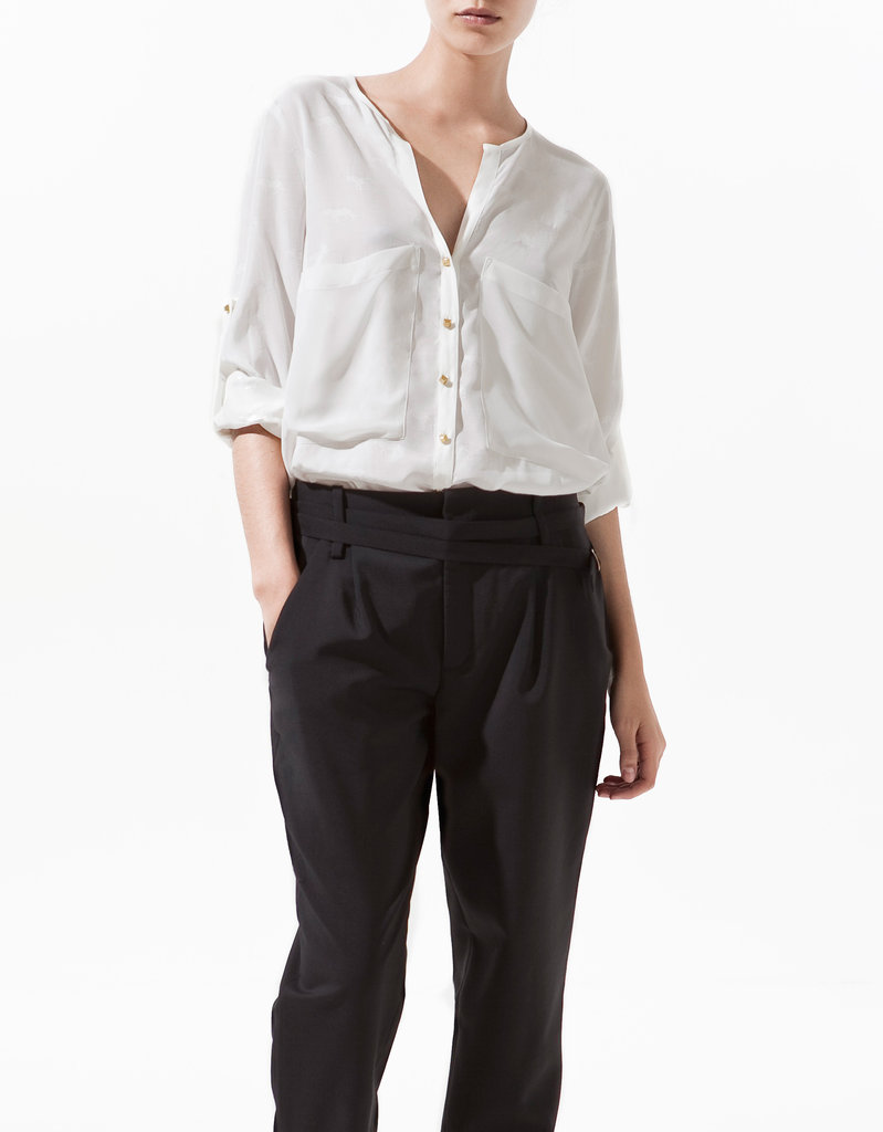 Every trip (no matter the destination) deserves one go-with-everything blouse. This slouchy top is breezy, sleek, and, like we said, will go with everything, from fitted trousers and flats to casual denim cutoffs and sneakers. Zara Jacquard Blouse With Contrasting Lapel ($80)