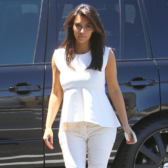 Kim Kardashian Wearing a White Peplum Top