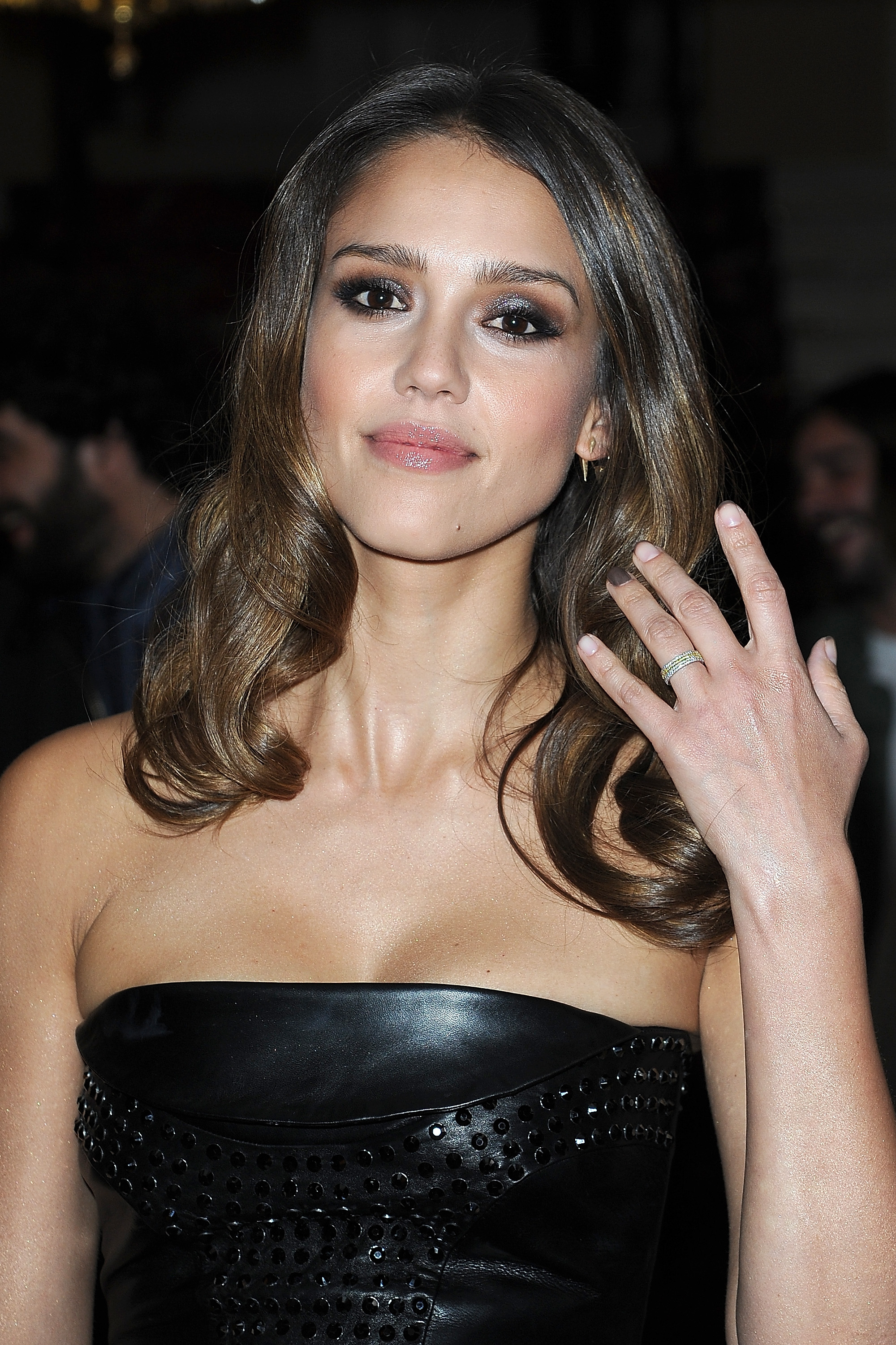Jessica Alba smiled at the Versace show for Paris Fashion Week.