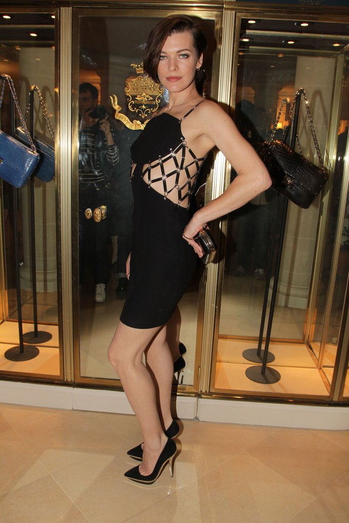 Milla Jovovich revealed the best part of her Versace LBD — the sultry side cutouts.