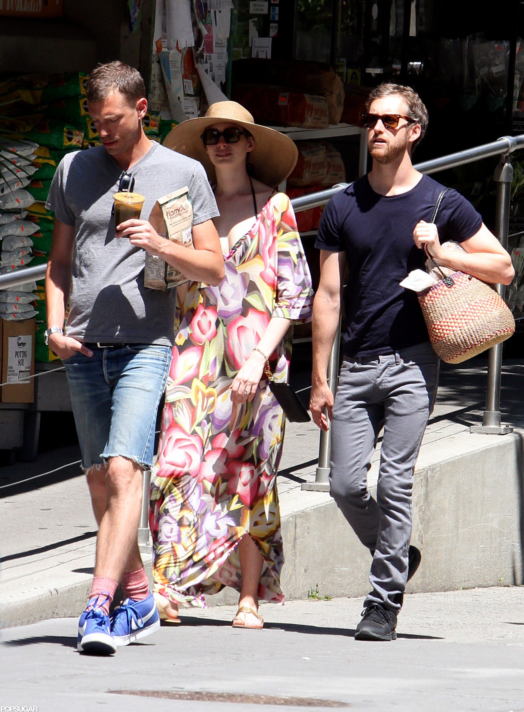 Anne Hathaway spent the holiday with her two main men, her brother Michael Hathaway and her fiancé, Adam Shulman.