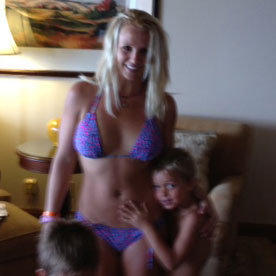 Britney Spears wore a purple bikini.  Source: Twitter User BritneySpears