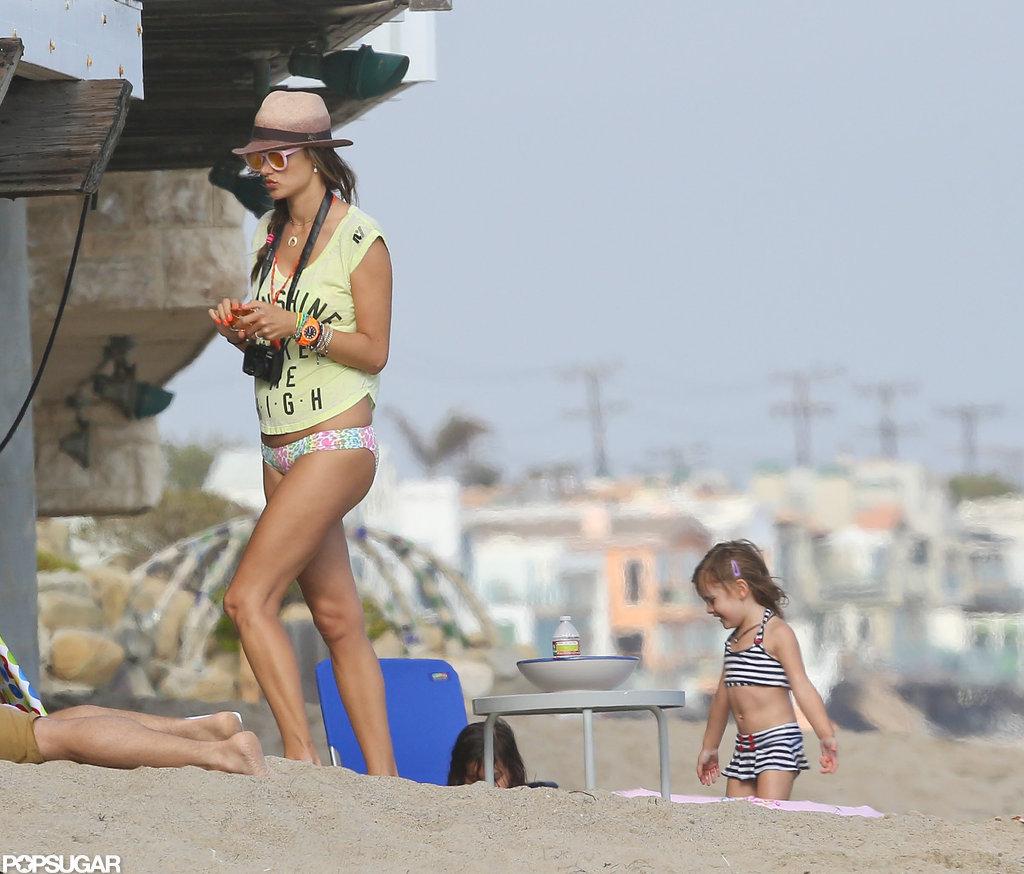 Alessandra Flaunts Postbaby Bikini Body and Shows PDA on the Beach