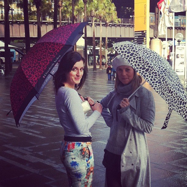 Sarah and Ali braved the wet weather in Sydney with their leopard print brollies!