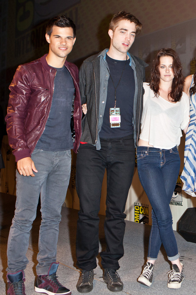 Taylor Lautner, Robert Pattinson and Kristen Stewart joined arms for a photo at Comic-Con in 2011.