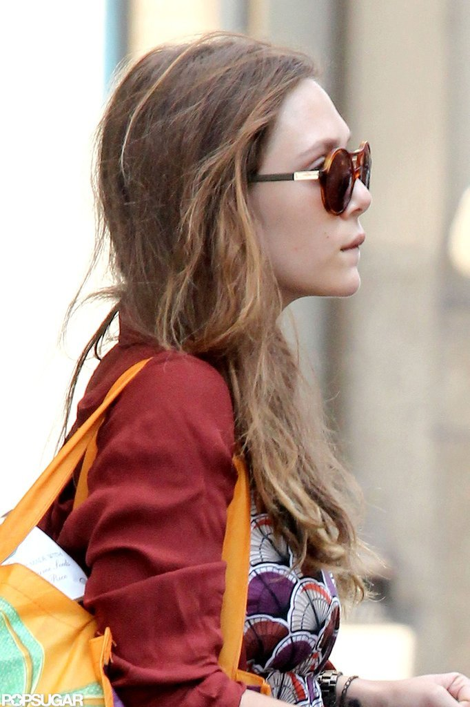 Elizabeth Olsen wore dark sunglasses.