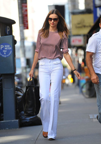 Miranda countered a whimsical-print Stella McCartney blouse with Summer-staple white denim for an insanely chic effect.