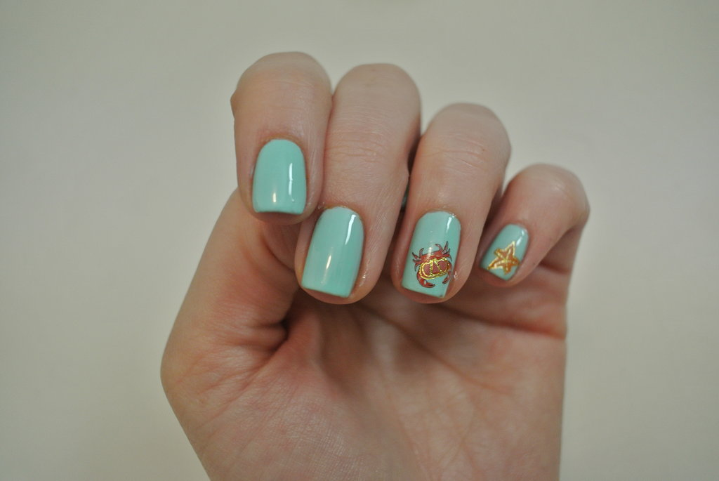 My under-the-sea themed nails! I finished with a generous application of top coat. I think this is important because you get that really glossy salon finish and it helps secure the transfer to the nail.