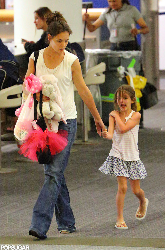 Katie Holmes and Suri Cruise Stick Together For a Commercial Flight