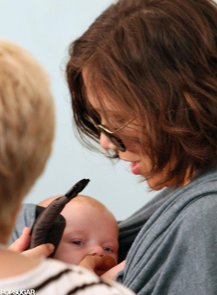 Maggie Gyllenhaal held baby Gloria.
