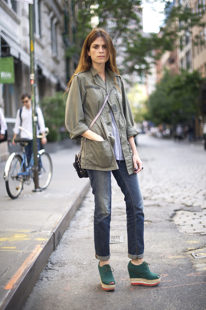 An easy way to rock your transitional wear? Mix the best of both worlds, like an army jacket and your favorite espadrille wedges.