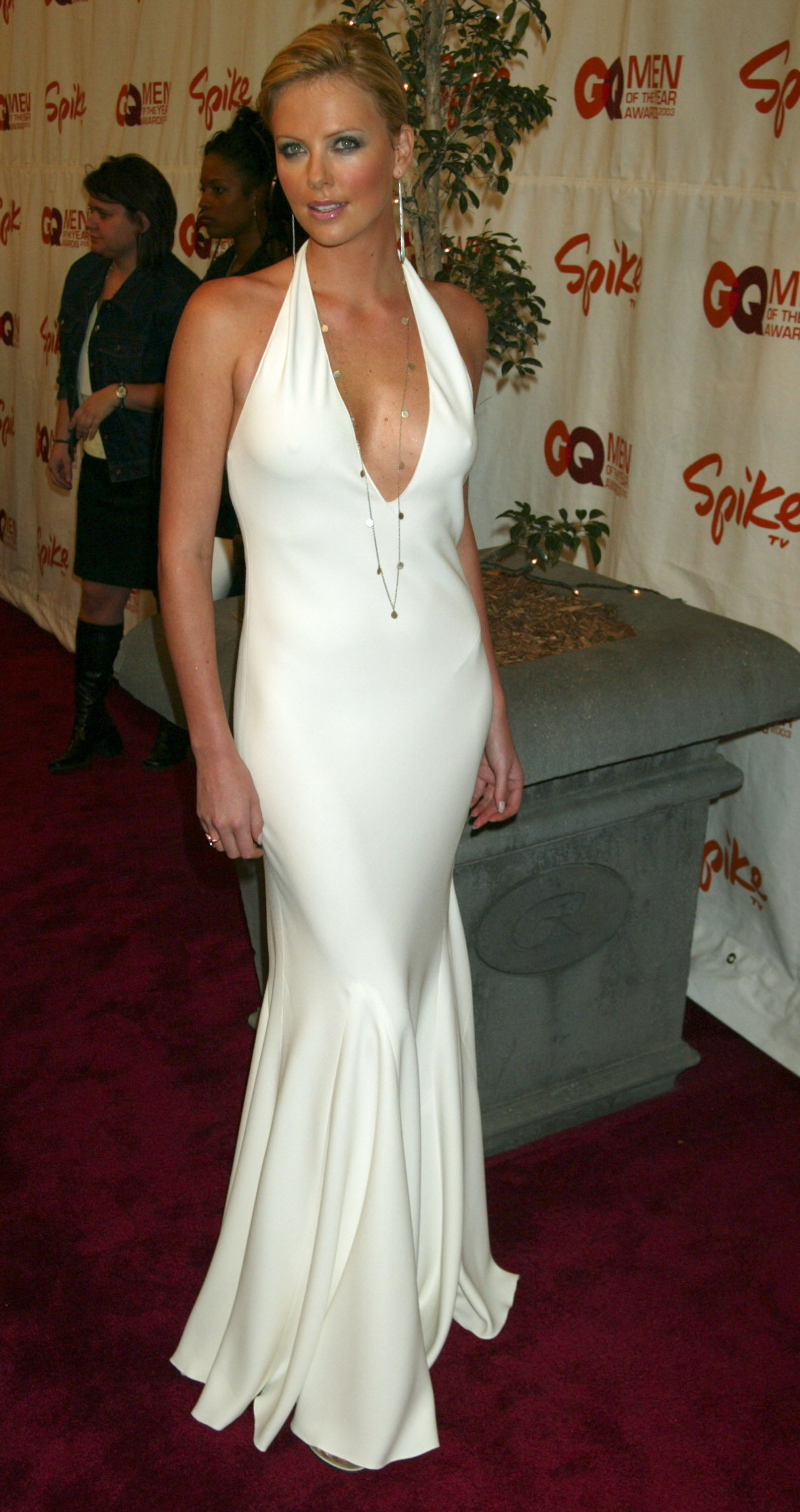 Charlize Theron looked white hot in a cleavage-baring ...