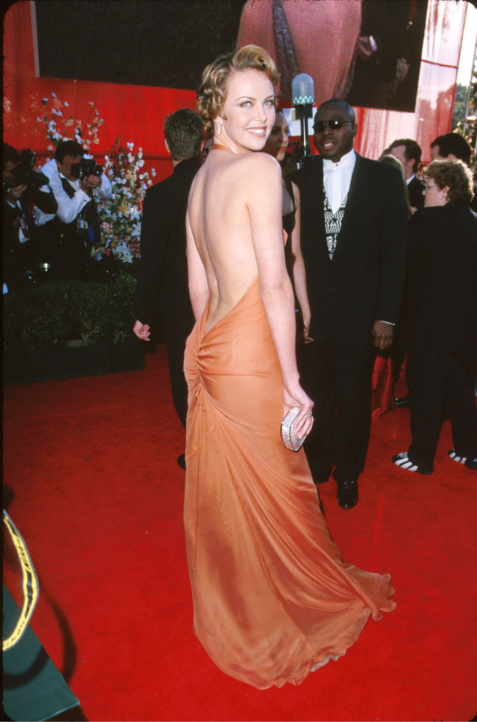 All eyes were on Charlize Theron at the Oscars in 2000. She wore a gorgeous low-cut tangerine dress that showed off her curves.