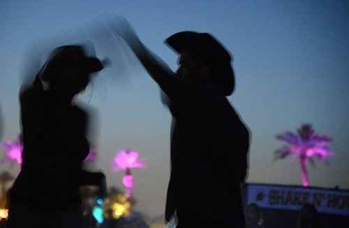 A couple danced to country tunes at the Stagecoach music festival.