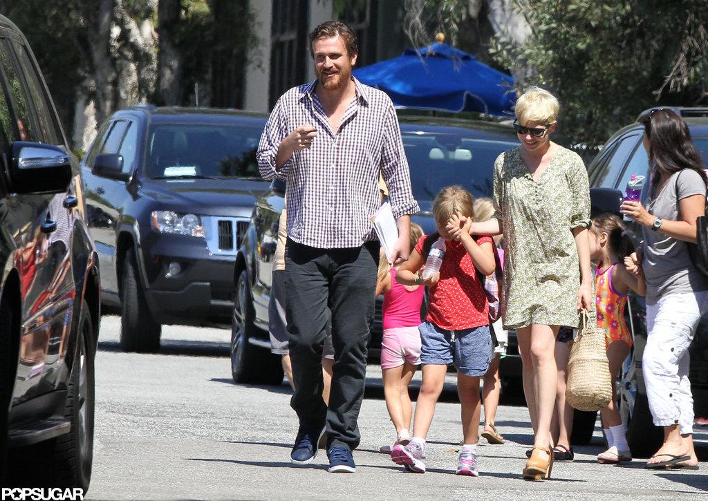 Matilda Ledger held hands with mom Michelle Williams and Jason Segel in LA.