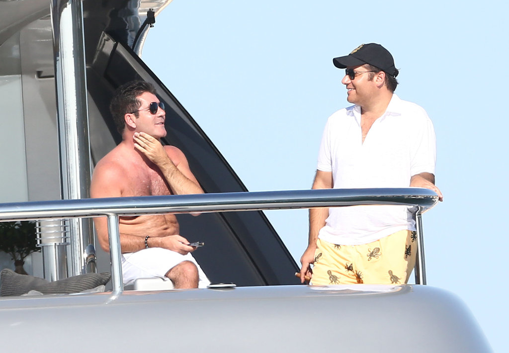 Simon Cowell chatted with a fellow shipmate.