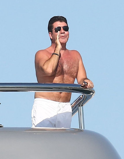 Simon Cowell called out to another yacht passing.