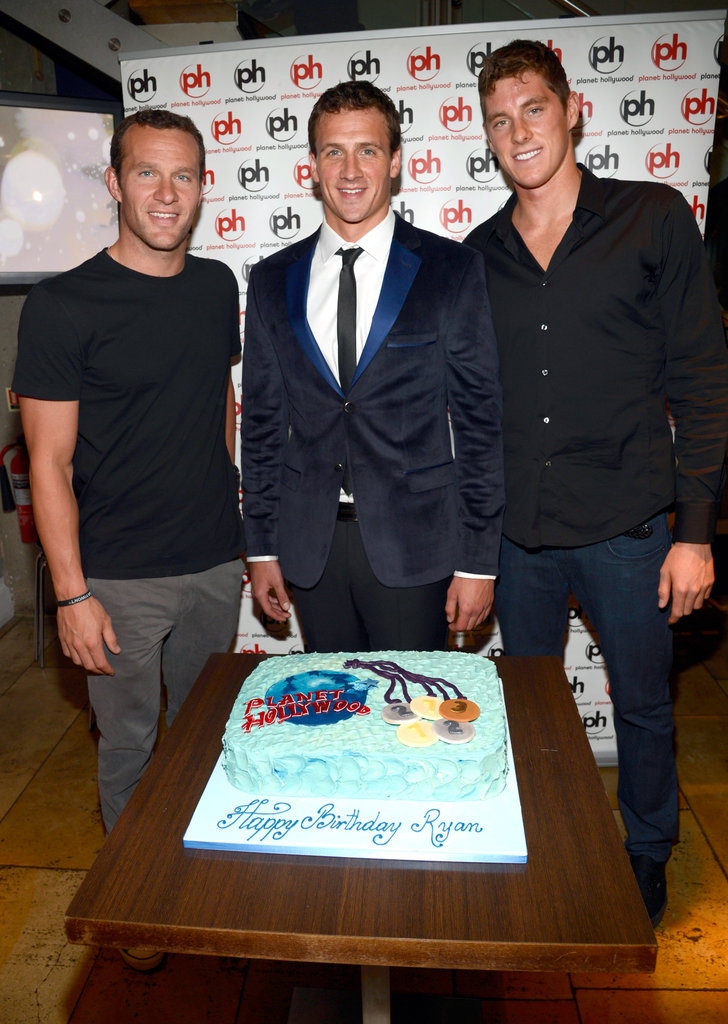 Ryan Lochte and his friends smiled with his Planet Hollywood birthday cake.