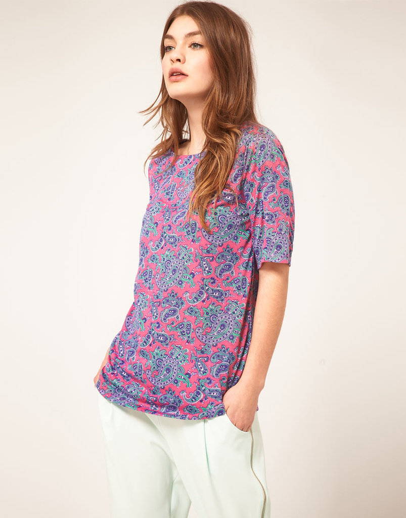 Inject your outfit with color and dynamic courtesy of a psychedelic paisley print — wear it with your boyfriend jeans, ankle-cut boots, and lightweight jacket, and you're ready for just about anything. ASOS T-Shirt With Bright Paisley Print ($23)
