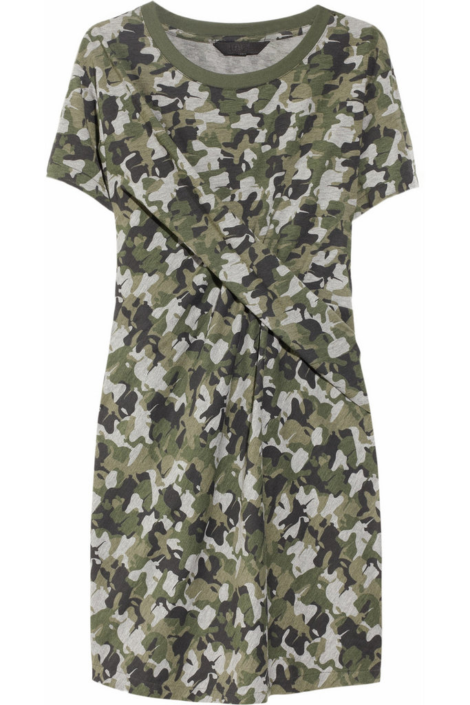 We'd wear this dress with suede ankle boots and a black — no, white — blazer with gold buttons. Karl Davin Camo-Print Twisted Jersey Dress (approx $208)