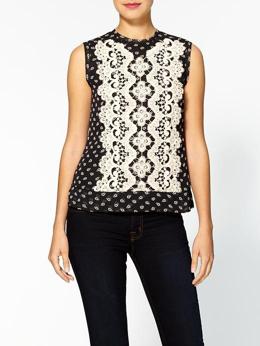 We love the mix of tiny flowers and sweet lace on this silk tank. Wear it with a pair of colored jeans — like cobalt blue or coral.  Nanette Lepore Blossoming Silk Top ($248)