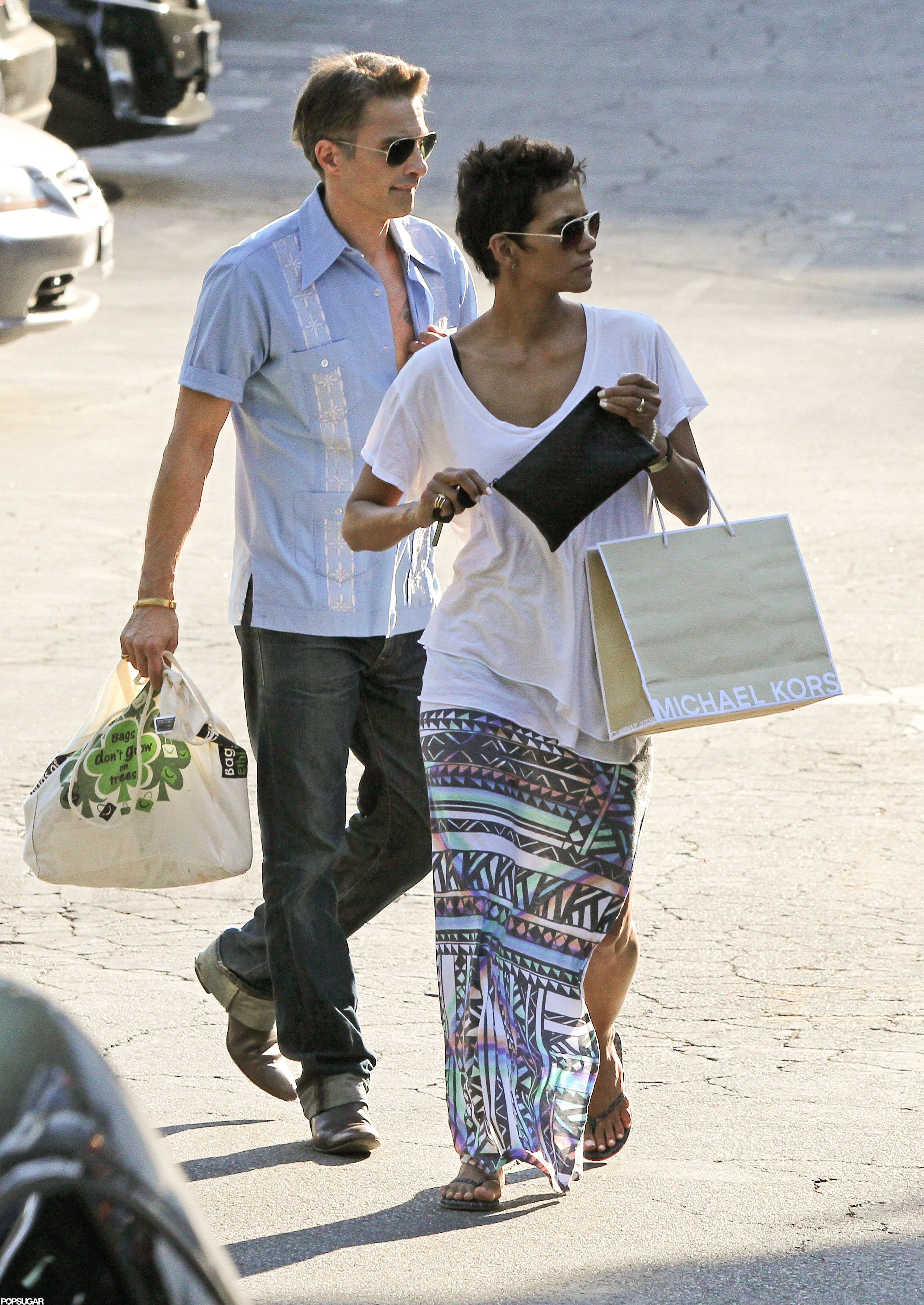 Halle Berry carried a shopping bag while out with Olivier Martinez in LA.
