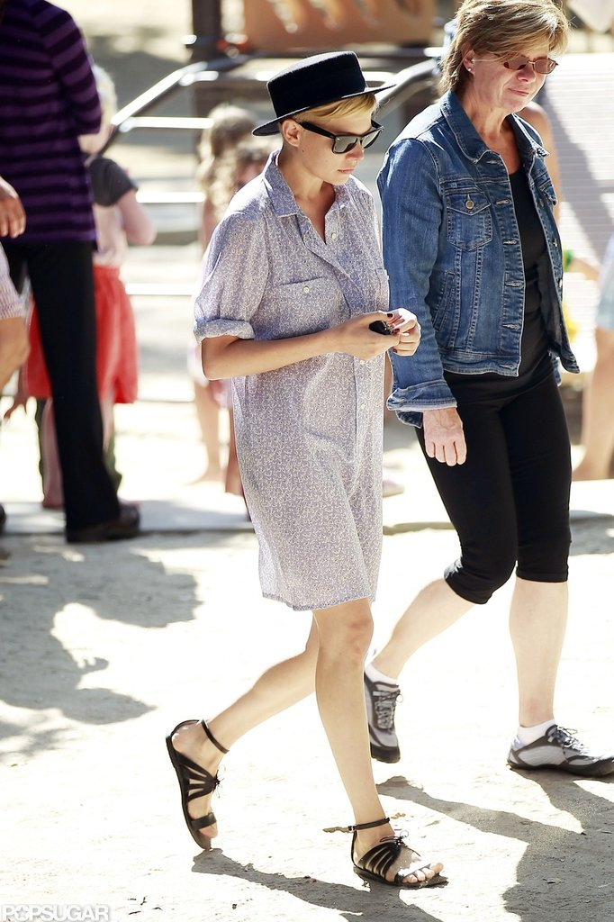Michelle Williams wore a black hat and sundress to the park.