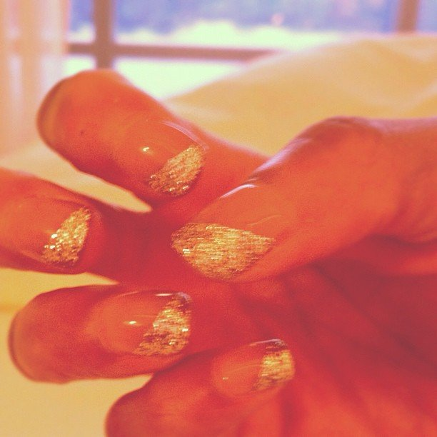 Tyra Banks got creative with her angled glitter gel nails.