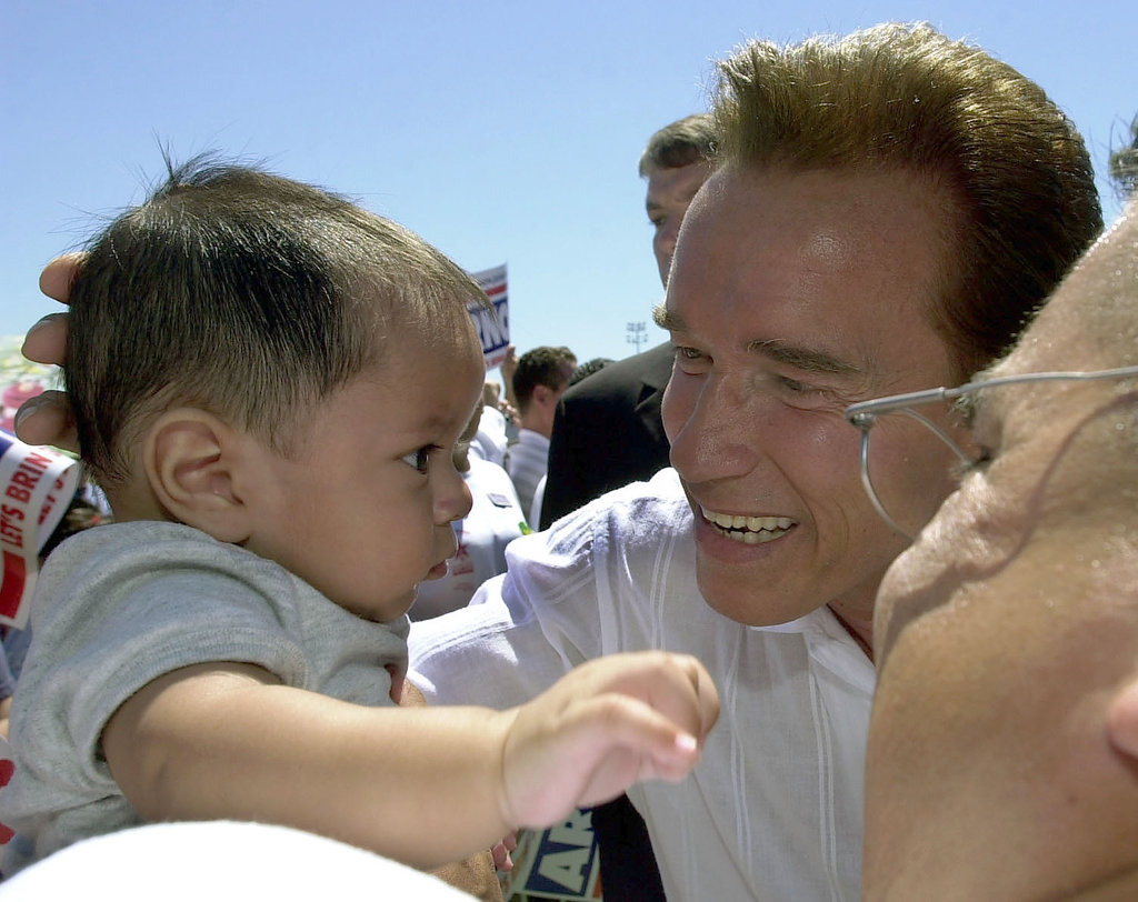 While running for governor of California in 2003, Arnold Schwarzenegger took time to say hello to a 5-month-old at a campaign rally.