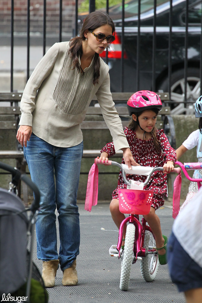 Katie Holmes showed Suri Cruise how to ride a bike Saturday in NYC.