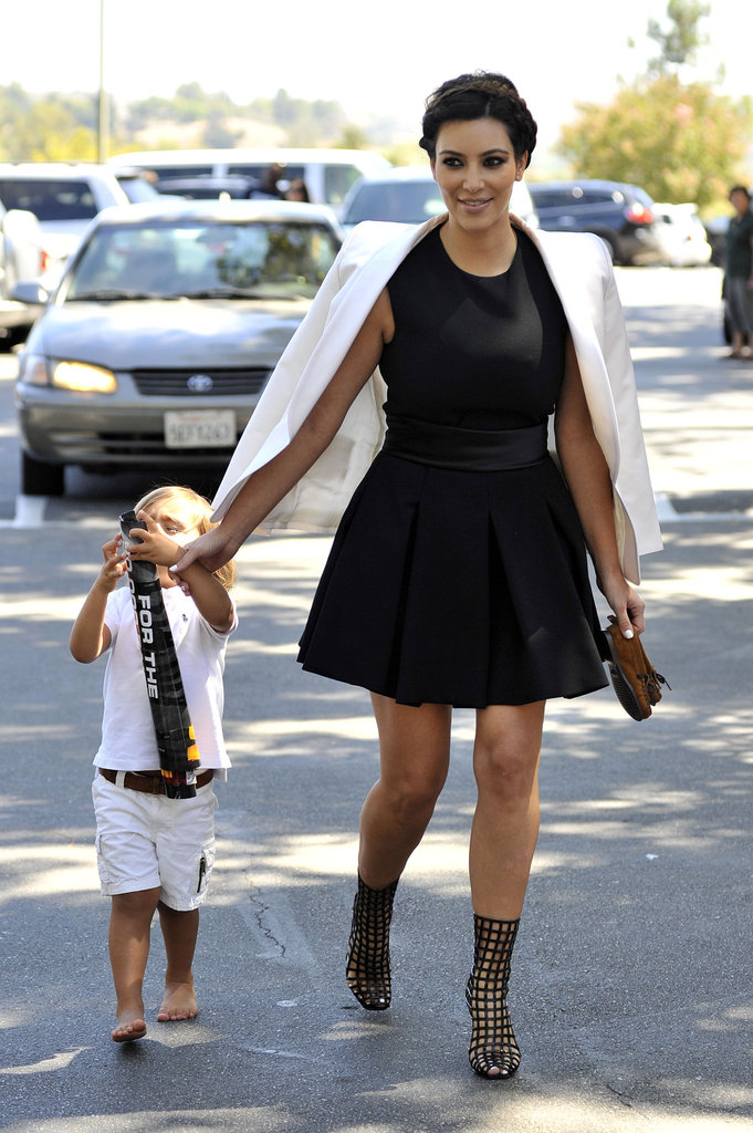 Kim Kardashian looked pretty darn fabulous as she entered a church service rocking a little black dress, white blazer and Yves Saint Laurent Cage Ankle Boots. Her Sunday best indeed.