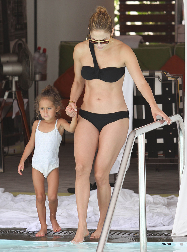 Jennifer Lopez showed off her toned torso in a black bikini to hit the pool in Miami with daughter Emme.