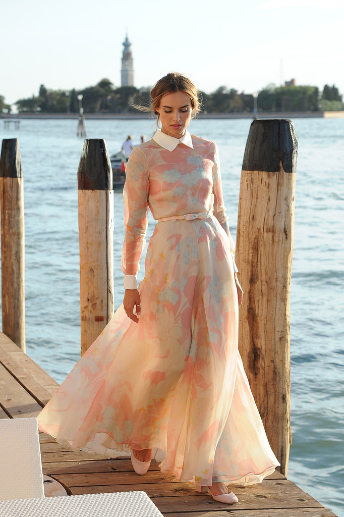 Polish actress wowed the crowd when she hopped off a jet boat in this stunning full-length, high-necked floral Valentino gown. The preppy white collar, smart cuffs and cute bow belt were intricate additions that made this one of the more unique dresses we've seen of late, and we love unique! The sheerness of the skirt makes the whole ensemble look rather dreamy.