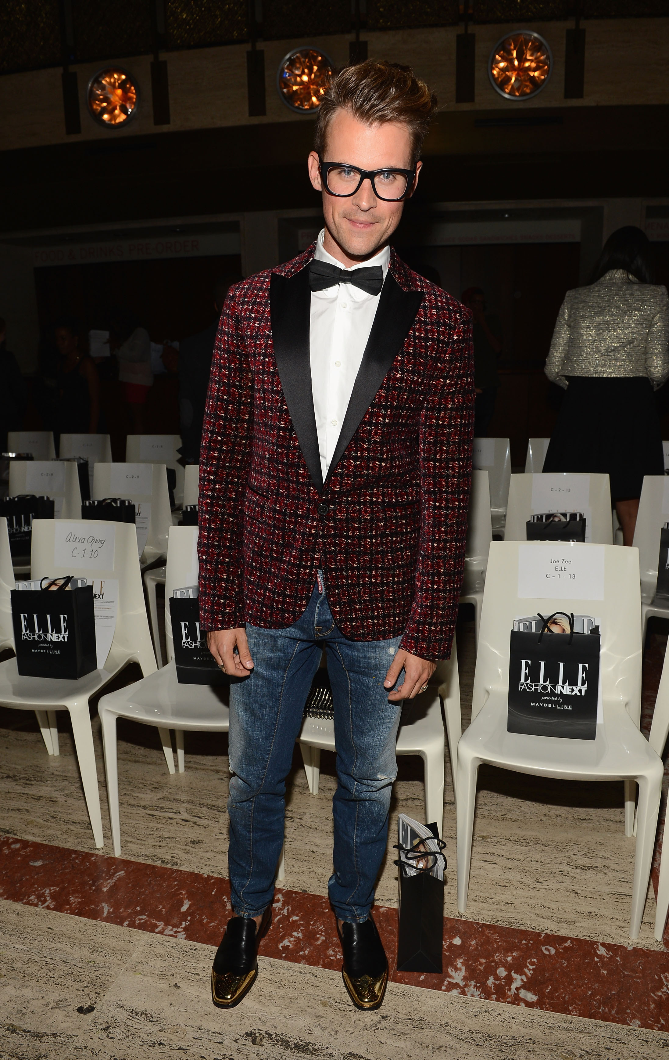 Brad Goreski dressed up his jeans look with a textured tuxedo jacket and bow-tie combo at the Elle Fashion Next show in NYC.