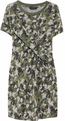 Slowly but surely, I've come to embrace the next wave of military-inspired pieces, courtesy of the cool camouflage print. This versatile Karl Davin Camo-Print Dress ($185), straight from the second installment of Karl Lagerfeld's Karl line for Net-a-Porter, is right up my alley — casual, but easily dressed up, in the perfect shades of green, and just begging to be worn to Fashion Week. — Marisa Tom, associate editor