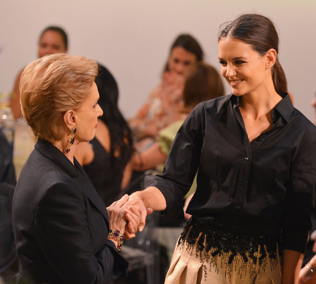 Katie Holmes greeted Carolina Herrera at the Style Awards.