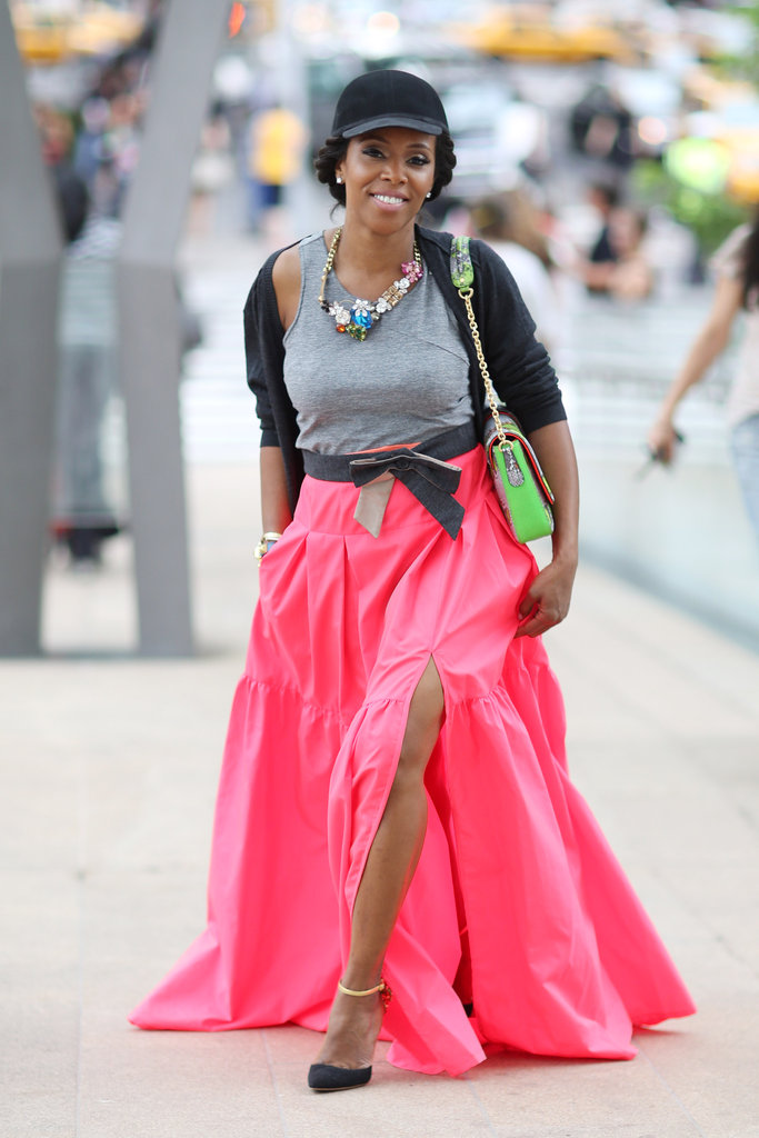 With statement jewels, a brilliant maxi, and a cool-girl cap, stylist June Ambrose made pulling off three bold trends look totally effortless. Source: Greg Kessler