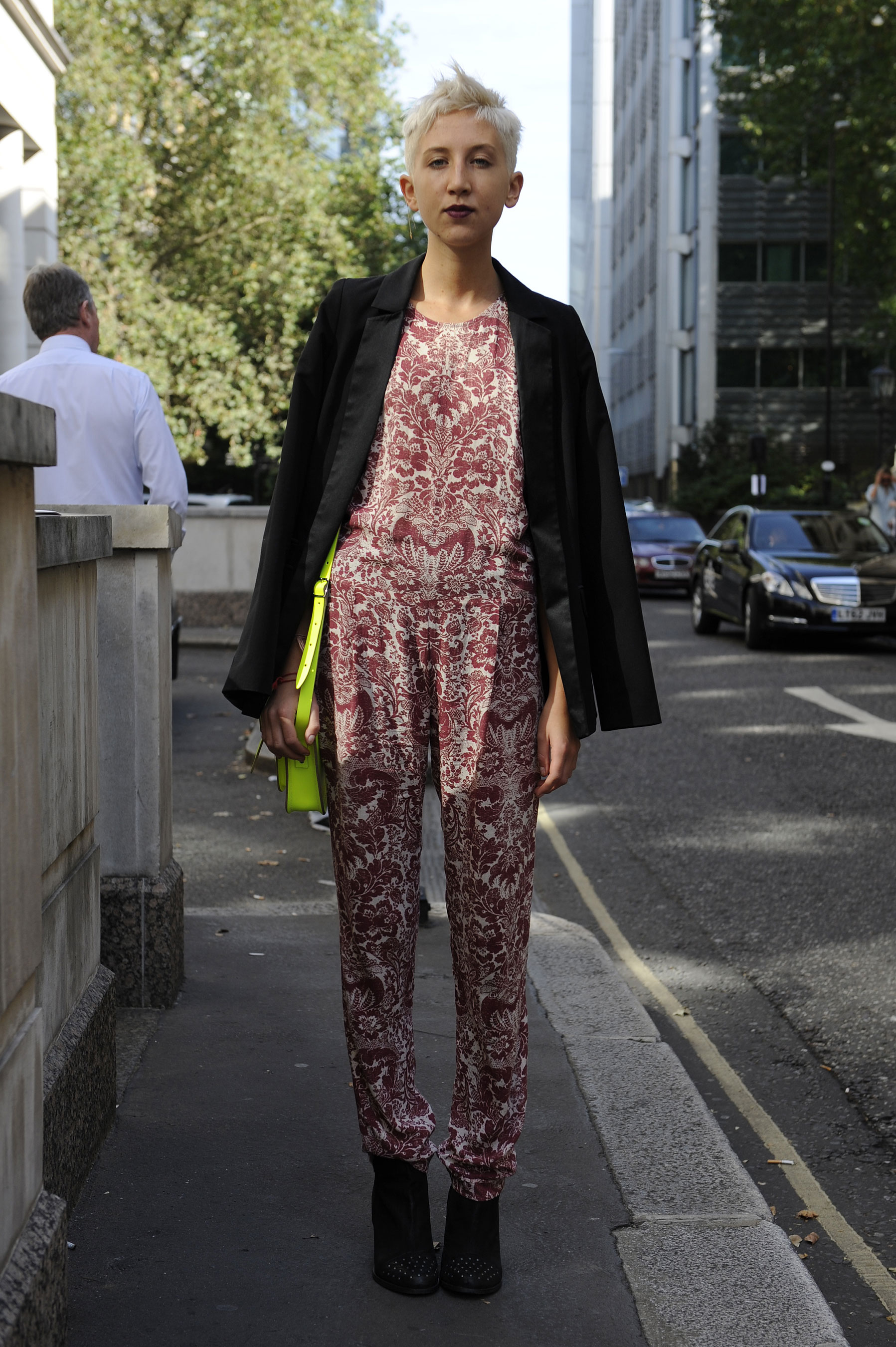 Bold styling was at work here; between the printed jumpsuit and neoprene satchel, this look was made to stand out.