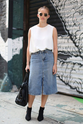 A denim skirt got revamped with round shades and a minimalist top.