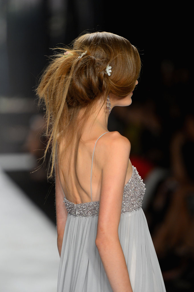 "Some of the words Badgley Mischka threw around for the hair look were chiffon, drapey, frothy, vintage petals, dusty colours, and lingerie. ""It's all about texture. We want it to float and feel like chiffon,"" said lead hairstylist Peter Gray for Moroccanoil. ""It's romantic with a twist."""