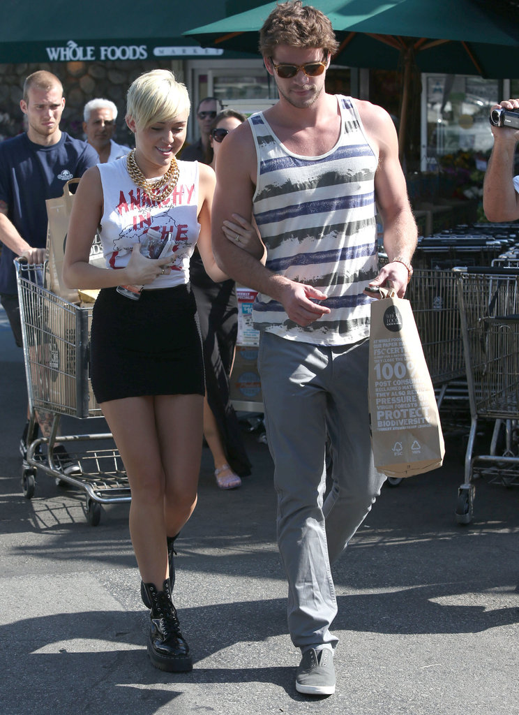 Miley Cyrus let Liam Hemsworth lead the way for her after a grocery shopping trip at an LA Whole Foods together in September 2012.
