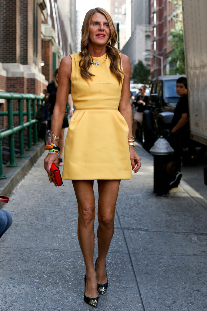 Anna Dello Russo took a polished approach to her stem-baring dress code in this sheath.