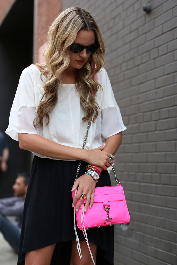 A pop of pink on her Rebecca Minkoff bag and an arm of bangles prepped this styler for a day at the tents. Source: Greg Kessler