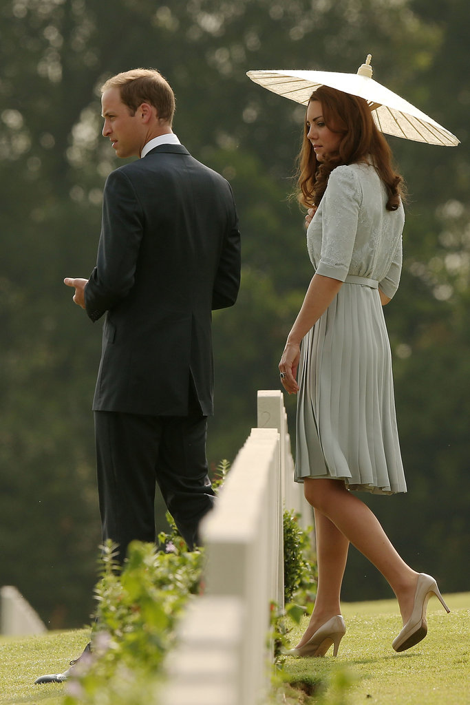 Kate Middleton donned a Jenny Packham dress with a white parasol to visit the Kranji War Memorial with husband Prince William.