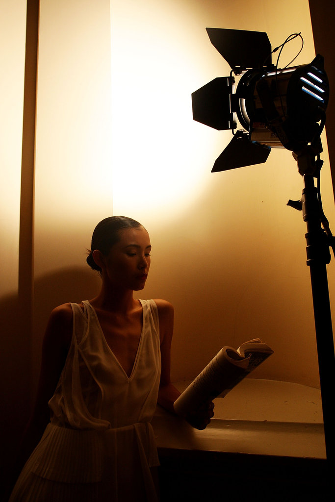 During Australia's Fashion Week last Fall, a model used backstage light to dig into her book.