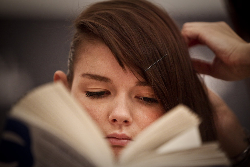 This bookish model got her hair done while reading backstage at Ana Moura's fashion show in 2011.
