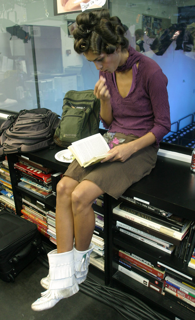 A model accessorized her Diane von Furstenberg Spring 2005 outfit with a book.