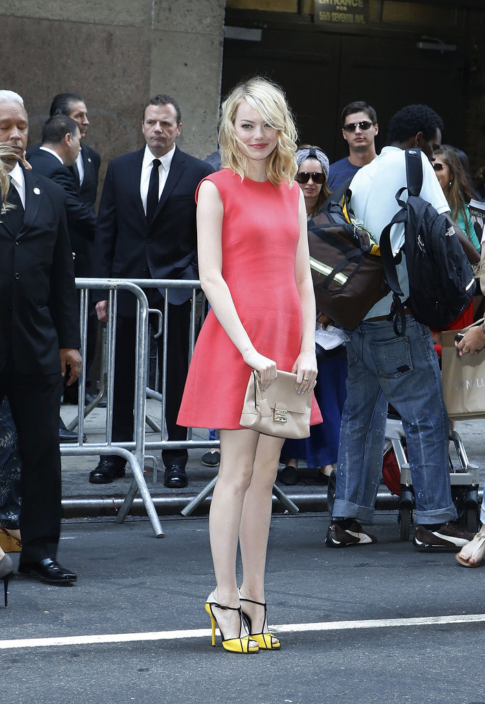 Emma Stone looked radiant in a coral-colored dress as she arrived for the Calvin Klein show at New York Fashion Week.